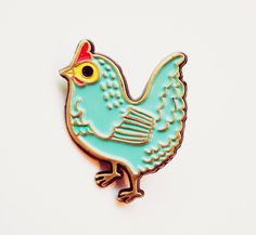 This cute blue hen will be sure to keep you company all day long and add a pop of color to any outfit! Handmade by BoyGirlParty, made of iron with a brass colored finish and four colors of enamel. Thi