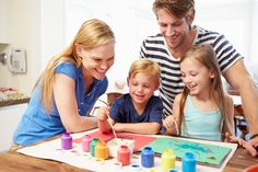 Parents Painting Picture With Children At Home...This is a review of my book, 33 Things to Know About Raising Creative Kids.