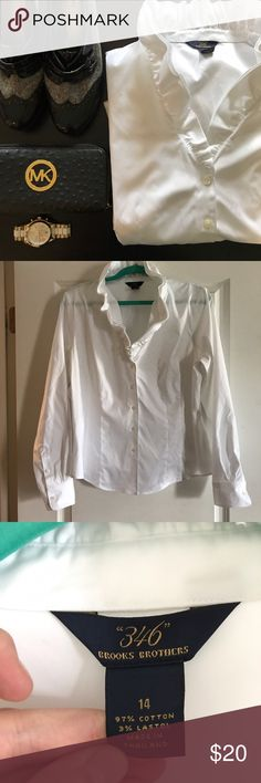 White Brooks Brothers 346 Ruffle Neck Button Up Like new button up with Ruffle neckline and long sleeves. Perfect condition, some stretch, almost no iron necessary! Crisp and perfect for the workplace! Measurements to come, materials in pics. Heels, wallet, watch not for sale nor included. 🚫NO TRADES🚫 Brooks Brothers Tops Button Down Shirts