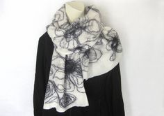 Felted Scarf, Felted Shawl, Black Scarf, Evening Shawl, Wool Wrap, Black Off-White Scarf, Woman Scarf, Floral scarf, Spring Scarf, Eco Scarf, Gift For Her ...................................................................................................  Hand felted scarf made with off-white, soft merino wool, silk and black Mohair thread. Cobweb felt is lightweight, warm, and soft.  Approximate measurements: 73 x 19.  Care: hand wash in COLD water, roll gently in a towel to remove excess…