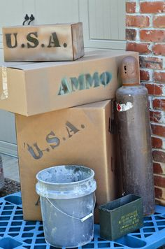 "Call of Duty Birthday Ideas. We made ""covers"" with pieces of plywood and stacked boxes in front of them that said USA or AMMO on them and then covered them with some brush we cut down in the woods. These ""covers"" were all over the yard and throughout the woods."
