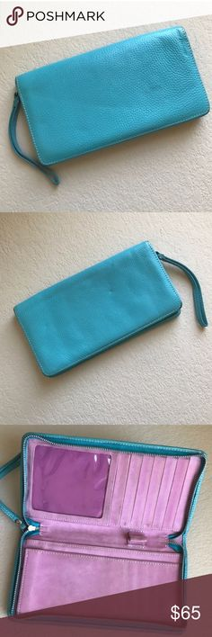 Designers Guild sky blue leather wallet/clutch Designers Guild sky blue genuine leather wallet/clutch. Genuine Leather exterior. Purple suede leather interior.   Small Designers Guild stamp on outer rim of wallet.  Enough room for credit cards, checkbook, and passport. No coin purse. Zipper closure. Designers Guild Bags Clutches & Wristlets