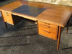 """Huge Mid-Century walnut and mahogany executive desk by Alma from their """"Castilian"""" collection. In the manner of Jens Risom. This is the Cadillac of desks -- a piece that would make even D..."""
