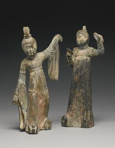 Two painted gray pottery figures of female attendants, Early Tang dynasty