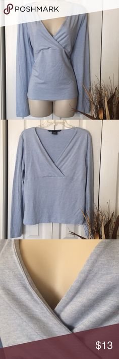 TH top with stretch Light blue. Textured look. Long sleeves. Crossover V neck. Normal signs of wash & wear, but a great top. See last photo zoomed in. Tommy Hilfiger Tops