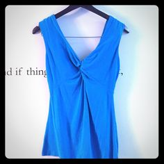 Express front knot tank-dark turquoise Adorable tank from Express. Only worn a couple times, no obvious signs of wear, front knot at bust, flares out toward bottom, very flattering! 57% cotton, 38% modal, 5% spandex. Express Tops Tank Tops