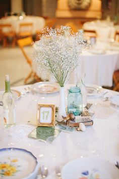 Love the tiny frame, the jars, the old books, all vintage and lovely on these tables!  Photography By / http://stofferphotography.com
