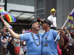 LGBT event will celebrate marriage equality. Photo: Jeff and Rob Green, of Covington, celebrate during the Cincinnati Pride Parade Saturday, June 27. The Enquirer/Madison Schmidt