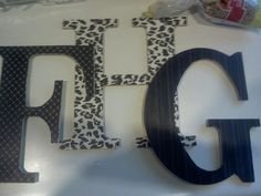 scrapbook paper modged podged onto wood letters