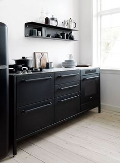 Kitchen Ideas Black open concept kitchen with breakfast bar counter. love the color