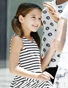 (Suri Cruise) Just wanted to remind everyone who's the real boss around here.