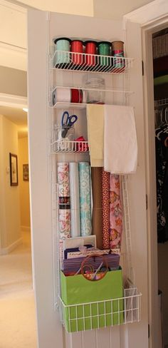 Use an over the door pantry thing - to organize ribbon/wrapping supplies.