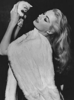 nousdevenonsgris:    lilianavonk:    hoodoothatvoodoo:    Anita Ekberg    This is the Crazy Cat Lady image that I myself strive to project.    ^