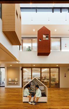 Child-level display (shelves in back left), and library space.    Kindergarten by Hibinosekkei and Youji no Shiro