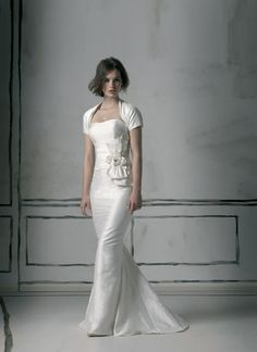 Justin Alexander wedding dresses style 8524 A classy figure flattering strapless sheath gown that is fabricated in silk dupion