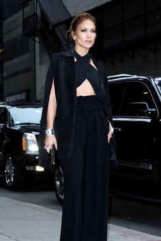 Jennifer Lopez always give a new style and adapt such fashion which is an elegant like her stylish black trouser, with her attractive physical appearance.
