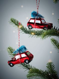 With tiny brush style trees tied to the roof and a festive red finish, our set of two car decorations will brighten up your Christmas tree and add a touch of vintage charm to your décor. With little window and wheel details, each comes with a whimsical red and white striped cord for hanging.