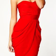 Red strapless drape bandage dress Beautiful and very flattering bandage dress with draping overlay at the bottom.  Ordered online, but never worn.  Still has security ribbon attached. Celeb Boutique Dresses Strapless