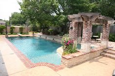 Ft. Worth Custom Pool Design photos, Weatherford, Keller : Pulliam - 212 Traditional Pool; Attached Spa with Pergola, Rounded Tile Ledge and Angled Overflow; Sheer Over Flow Fountain and Lions Head Fountains, Double Brick Coping
