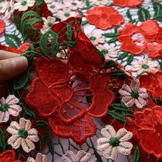 1m wide or a tad more perhaps heavy polyester lace in red, green and pink.  It is a bold guipure type lace quite amazing and gorgeous to look at. Lots of intricate work and worth a bob or two, almost the most expensive fabric we have ever had. £27.00 PM