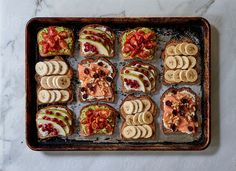 Assortment of breakfast toasts on baking tray from above. Health & Wellness gallery by Trent Lanz for Stocksy United - Royalty-Free Stock Photos.  assortment, avocado, baking tray, banana, berries, bread, breakfast, candied, cherry tomato, cooked, cream cheese, cut, daylight, different, eating, food, fresh, from above, fruit, health, healthy, homemade, horizontal, indoors, kitchen, meal, nobody, nutrition, organic, peanut butter, pear, snack, table, toast, tomato, tray, vegan, walnut…