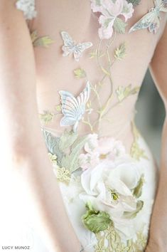 Papillion Couture Wedding Dress with Illusion Back by Wedding Dress Designer Claire Pettibone | You are the canvas upon which a beautiful Still Life is painted. The PAPILLON wedding dress is the quintessential unique creation. Ivory beaded floral embroidery accented with colorful tinted butterfly appliques and a stunning sheer back