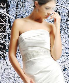 Nadia. Beautiful strapless luster Satin wedding dress. Simple and elegant with soft gathering across the bodice and down the natural waist and skirt. Waistline embellished with a very pretty beaded ribbon belt. Sweep train. Available in white or ivory.