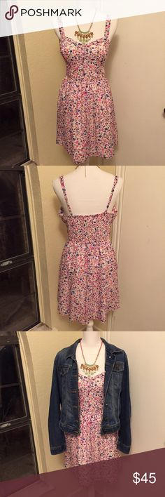 Candie's Pretty Floral Dress This lovely dress features pinks and oranges over white. It has a white lining and a half elastic waist hidden in the back which makes it super comfortable. The straps ARE adjustable. Perfect for warmer weather, church, or Easter Sunday. Looks great with a denim jacket or light cardigan. Only worn/washed once to a wedding, looks new. *Perfect for bundling with the blue dress in another listing.* Candie's Dresses