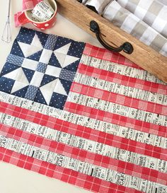 Carried Away Quilting sews the 4th of July Flag block designed by Lori Holt. Fabrics: Moda, including collections from Lella Boutique, Sweetwater and Kate & Birdie. Patriotic Quilt. Red white & blue.