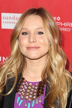 Kristen Bell: Kristen Bell styled her hair in long, loose waves for the premiere of The Lifeguard. The mom-to-be kept her makeup look light with shades of champagne and pink throughout.