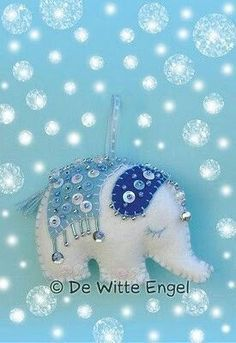 Cute embellished felt elephant ornament. Lots of pretty felt ornaments on this page.