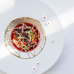 London is blooming! @jeanphilippeblondet at Alain Ducasse at the Dorchester, goes all floral with a limited edition lunch menu. Here, the Pistachio and Strawberry field. @alainducasse Yummery - best recipes. Follow Us! #kitchentools #kitchen