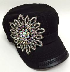 This large rhinestone flower adorned cap will turn heads! Have a great hat day! Cadet style cap with adjustable back and hole for ponytail.
