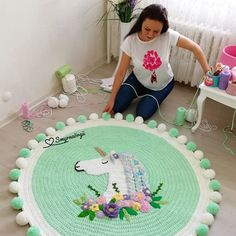 Image may contain: 1 person - imaginary dream Crochet Carpet, Crochet Yarn, Arm Crocheting, Knit Rug, Pom Pom Rug, Knitting Accessories, Baby Decor, Crochet Projects, Crochet Patterns
