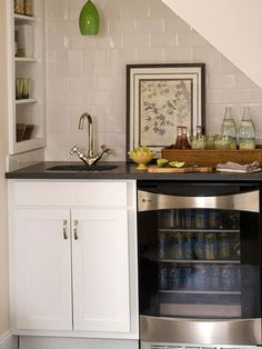 this wet bar with wine storage is great use of under the stairs