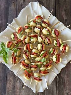 These mini BLT sliders have all the vibrant flavors of your favorite bacon lettuce and tomato sandwich on a toothpick. They're easy to pick up and eat, and your guests will love the flavors of these small bites — especially the crispy bacon!Best of all, the recipe is super simple and the fresh colors look so pretty on the plate. The bright reds and greens make these skewers a perfect holiday appetizer. If you love small bites with bacon as much as we do, be sure to check out our roun… Skewer Appetizers, Holiday Appetizers, Appetizer Recipes, Mini Blt, Slider Sandwiches, Natural Grocers, Best Bacon, Tomato Sandwich, Summer Tomato