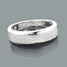 Affordable Sterling Silver Wedding Bands: This Mens Diamond Ring weighs approximately 4 grams and showcases carats of genuine diamonds. Featuring a classic design and a luxurious rhodium plating for extra shine, this men's diamond ring is a great alt Mens Diamond Jewelry, Sterling Silver Diamond Rings, Silver Diamonds, Silver Ring, Craft Jewelry, Silver Jewelry, Silver Earrings, Unusual Wedding Rings, Wedding Rings For Women
