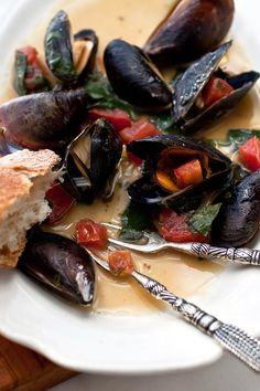 Mussels don't have to be steamed They will pop open in a hot, dry cast iron skillet on a grill or in the oven In this dish they are first tossed with garlic, olive oil and wine, then roasted along with the marinade in a pan in a hot oven