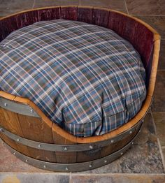 Wine Barrel Dog Bed - you can purchase one or if you are crafty you can make this a DIY project.