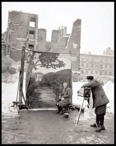 Let's pretend it never happened...  A photographer uses a backdrop to facade Warsaw's war-torn remains. 1946. By Michael Nash