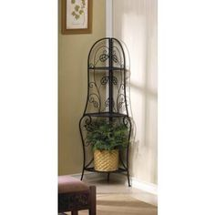 CORNER BAKER SHELF by Smart Living Company Retail Price: $69.95  PRODUCT DESCRIPTION: A sweet treat for any room, this corner baker shelf will display your plants, collectibles and more while enhancing your room with its pretty design. Trellis-inspired shelves climb up the curling metal frame thats decorated with lovely leaves. It will bring any dull corner to life!  http://www.smartlivingcompany.com/metal-corner-shelf
