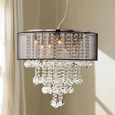 This magnificent chandelier is finished in brushed nickel, with hanging crystal and a gorgeous sheer black shade.