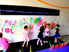 painters tarp with white butcher paper.  Tempera paint in clear cups and let them go to town painting a mural like Rapunzel!