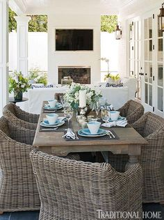 Bill and Giuliana Rancic decorate their poolside patio dining area with classic blue and white tableware - Traditional Home® / Photo: Michael Garland / Design: Lonni Paul