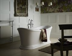 Heritage Bathrooms Orford freestanding bath. - Be inspired with boutique-hotel styling by placing a chair near your luxurious Orford freestanding bath. Pair it with dramatic floral patterns for an indulgent look.