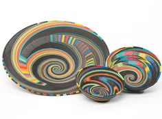 Africa | 'Rainbow colours' Telephone wire baskets from South Africa