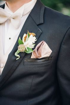 Fresh White and Blush Boutonniere   Justin  Mary Photography   TheKnot.com