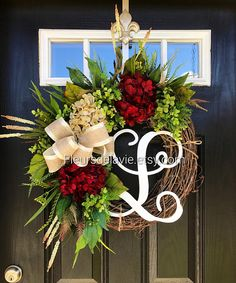 Available to ship after Dec. 10th! New item!! This gorgeous door wreath is ready to grace your front door! Made up on a 18 grapevine wreath with moss, mixed greens of ferns, and maple leaves, and ficus leaves. Gorgeous burgundy and cream hydrangeas with cream accents make up this