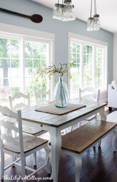 Kitchen Living Room Summer Home Tour - The Lilypad Cottage; color and simplicity for breakfast nook. - Summer Home Tour, lots of fun color and summer touches in this lake home tour. Farmhouse Table, Country Farmhouse, Farmhouse Decor, Kitchen Country, Kitchen White, Farmhouse Design, Kitchen With Blue Walls, Rustic Table, Table And Chairs