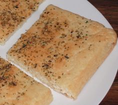 Paleo flatbread: Mix  1/2 c. almond flour, 1 t. b.powder, dash salt; Add  2 eggs, 1T. coconut oil. Pour in 8x8 parchment covered pan. 350 for 18-20 minutes. Top w/ herbs & olive oil.